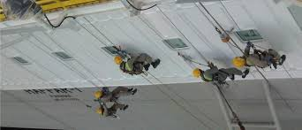 offs accommodation block painting using rope access team