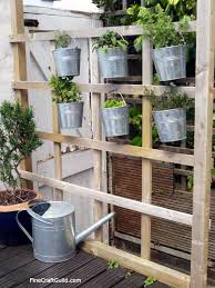 vertical herb garden with galvanized buckets finecraftguild com