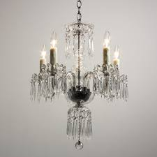 beautiful antique five light chandelier dating from the 1920 s made of glass with icicle prisms the chandelier begins with an understated chrome canopy