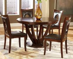image of solid round dining table with chairs