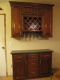 contemporary kitchen with polished brass cabinet bar handle and cherry wood wall mounted cabinet wine rack