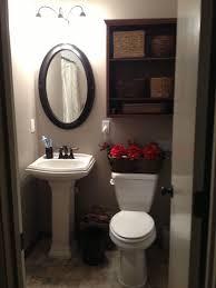 bathroom pedestal sink. Small Bathroom Remodel. Gerber Allerton Pedestal Sink, Avalanche Toilet, Custom Shelf, Benjamin Moore Sandlot Gray Paint, Mirror And Baskets From Sink