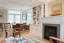 built in cabinets next to fireplace living room traditional with built in cabinets transom windows