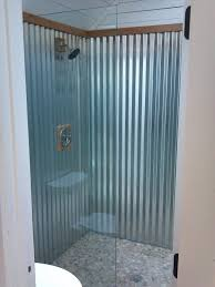 glorious galvanized bathroom with corrugated shower pebble