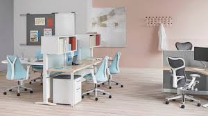 herman miller home office. a healthcare office with setu and mirra 2 chairs exclave tackboards systems desks herman miller home c