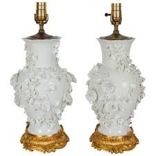 pair of antique blanc de chine porcelain lamps with raised flowers for