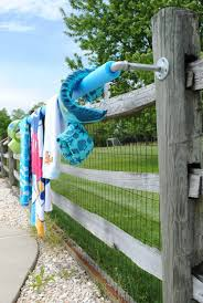 this diy pool towel rack solves the problem of lacking a place to hang towels pool