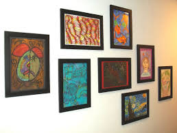 the art teachers of becker got together and each chose 2 pieces of art created by students these 8 pieces of art are hanging in the district office to show artwork for the office