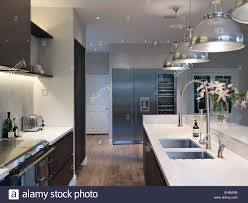 modern kitchen with pendant lights above island unit residential house thurleigh road clapham lighting over peninsula