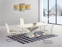 white extending gloss dining table and 4 chairs