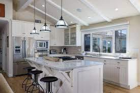 Traditional l shaped kitchen with carrara white marble breakfast bar island