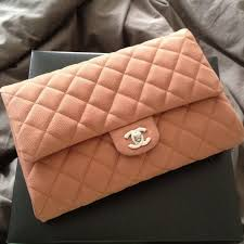 chanel clutch. authentic chanel clutch on a chain in light brown m