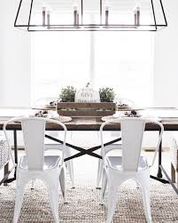 the tolix style white chairs are from walmart farmhouse dining room with tolix style white