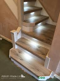 Staircase in Arlington Oak with white risers, built in lights & glass  balustrade.