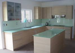 backpainted glass countertops in a modern kitchen