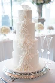 Round silver wedding cake stand. #whiteweddingcake #frills #ruffles Cake  stand hire available
