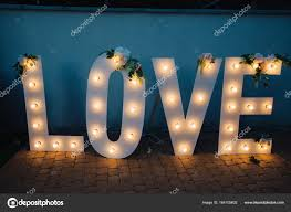 Big Letters With Lights Big Glowing Love Letters With Light Bulbs Stock Photo