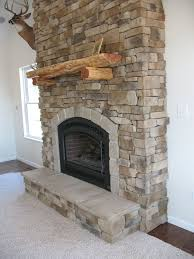 here is a side view of gas fireplace veneered with cultured stone