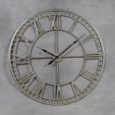 striking silver skeleton wall clock