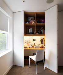 closet office space. a builtin desk wardrobe conveniently utilises wasted space in the whilst opening closet office