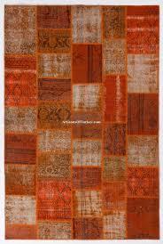 orange rust patchwork rug made from overdyed vintage turkish carpets