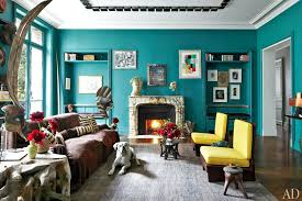 teal and yellow living room bright teal walls a marble fireplace grey area rug and yellow teal and yellow