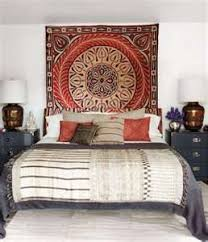 bohemian bedroom ideas - a boho rug on the wall creates a headboard look  and adds a great pop of color and interest.