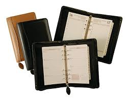 tan black wire bound weekly planners