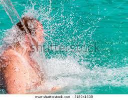 pool water splash. Stream Of Water Splash On Man Head In Swimming Pool A