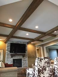 faux coffered ceiling in a new living room made from custom rough sawn beams