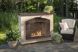 com outdoor great room stone arch gas fireplace with stucco finish garden outdoor