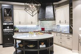 this trendy kitchen display in e w kitchens wixom location features many of the must have elements of the moment including nature inspired cabinets