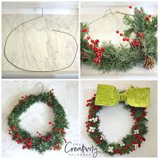 DIY Christmas wreath using a hanger and greenery.