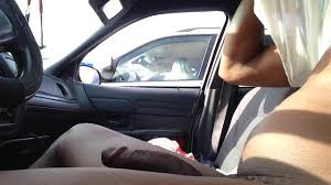 Charming blonde sees his large black dick exposed in the car.