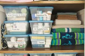 organized towels in bathroom linen closet