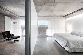 Example of a trendy concrete floor and gray floor bedroom design in Sydney  with white walls