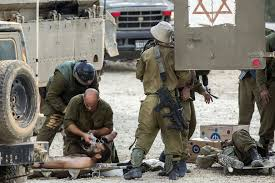 scenes of war and heartbreak as hamas conflict intensifies   i iers evacuate their wounded comrades at an army deployment area near 8217
