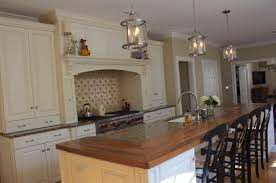 white kitchens with walnut wood countertop white cabinets