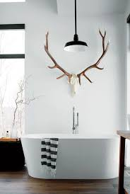 antler towel holder gives this modern bathroom a cabin feel