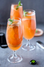 gfruit beer shandy filled gles with a fresh mint and pink gfruit garnish awesome summer