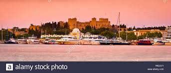 Palace of the Grand Masters & Mandraki Harbour illuminated at dawn, Rhodes  Town, Rhodes, Greece Stock Photo - Alamy