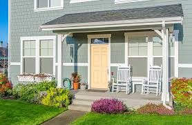 What is a Porch? Small front porch on gray home with yellow door