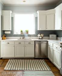 White painted kitchen cabinets Diy Painted Builder Oak Cabinets White Diy It All Started With Paint How To Paint Builder Grade Cabinets