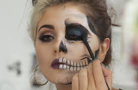 add a touch more definition by using a white eyeliner pencil to fill in the teeth slightly drawing on a few lines in each to create the look of teeth