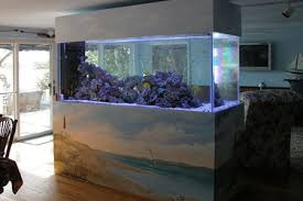 Awesome Fish Tank Living Room Ideas Above Black Wooden Table Plus Fish Tank Room Design