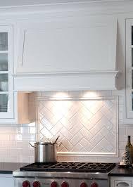Herringbone subway tile under hood Gorgeous simple hood, and herringbone  pattern title backsplash - by Mullet Cabinet