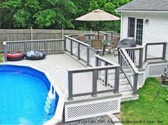 above ground pool with deck attached to house. Attractive Above Ground Pool Deck For Enjoyable Home Exterior Ideas: Splendid Oval Ideas With White Ladder And Brown Chair Attached To House N