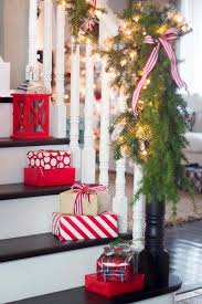 One easy Christmas decoration idea is to place small wrapped gifts on the  stairs.