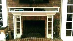 tv stand over fireplace concealed over fireplace wall mirror cabinet over