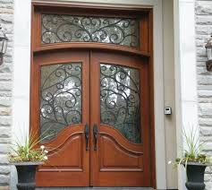 front door with glass insert and intricate detailing